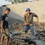 Dewey shovelling concrete