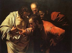 Thomas putting finger in Jesus side by Caravaggio